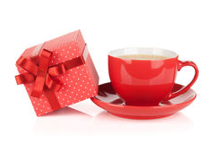 Red coffee cup and gift box with bow Royalty Free Stock Image
