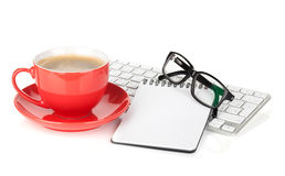 Red coffee cup, glasses and office supplies Royalty Free Stock Photos