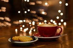 Red coffee cup and green plate with cookies Stock Photography