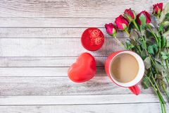 Red coffee cup with heart and rose Valentines Day concept stock images