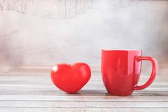 Red coffee cup with heart Valentines Day concept royalty free stock photo