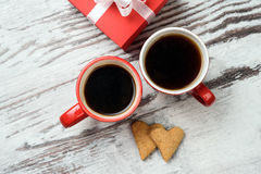 Red coffee cup, hearts cokies and gift box. Stock Image