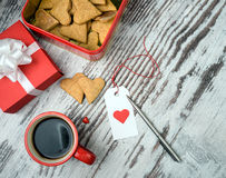 Red coffee cup, hearts cokies and gift box. Royalty Free Stock Photos