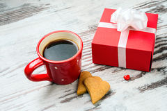 Red coffee cup, hearts cokies and gift box. Royalty Free Stock Image
