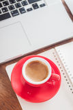 Red coffee cup with notepad and laptop Stock Images