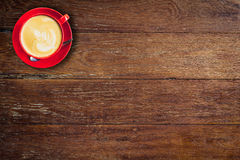 Red coffee cup on old wood background Royalty Free Stock Photo