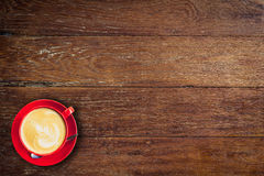 Red coffee cup on old wood background Stock Images