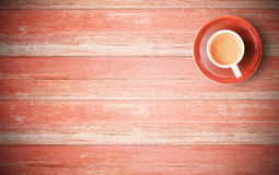 Red coffee cup on old wood background Royalty Free Stock Images