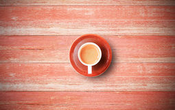 Red coffee cup on old wood background Royalty Free Stock Image