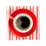 Red coffee cup over kitchen towel Stock Image