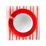 Red coffee cup over kitchen towel Royalty Free Stock Photos