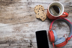 Red coffee cup, Red headphone and chocolate chip cookies on the wooden table. View from above. Coffee with chirstmas concept.  Stock Image