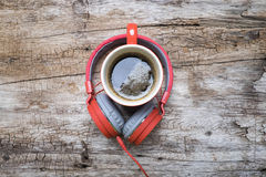 Red coffee cup, Red headphone and chocolate chip cookies on the wooden table. View from above. Coffee with chirstmas concept Stock Photo