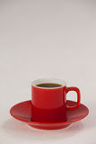 Red coffee cup on saucer Royalty Free Stock Images