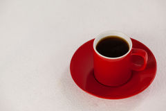 Red coffee cup on saucer Stock Photos