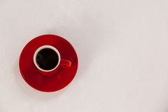 Red coffee cup on saucer Royalty Free Stock Photography