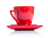 Red coffee cup on saucer isolated Royalty Free Stock Image