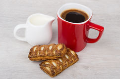 Red coffee cup, stuffed flaky cookies and milk jug Stock Photography