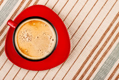 Red coffee cup on tablecloth Royalty Free Stock Photography