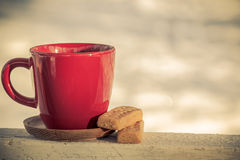 Red coffee cup tea cup with classic shortbread butter cookies on a winter background Royalty Free Stock Images