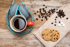 Red coffee cup, Vintage headphone and chocolate chip cookies. Royalty Free Stock Photo