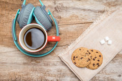 Red coffee cup, Vintage headphone and chocolate chip cookies Royalty Free Stock Image