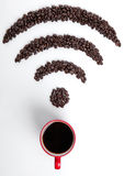 Red coffee cup with wi-fi icon beans for cafe Royalty Free Stock Photo