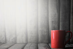 Red coffee cup on wood table background with light leak Royalty Free Stock Images