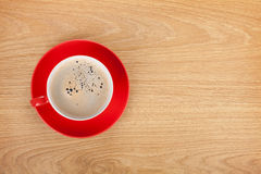Red coffee cup on wooden table Stock Photos