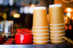 Red coffee cups and paper cups on coffee machine Stock Photography
