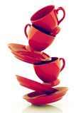 Red coffee cups with saucers. 3D rendering Royalty Free Stock Photo