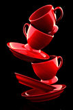 Red coffee cups with saucers. 3D rendering stock illustration