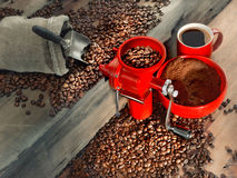 Red coffee mill and coffee beans Stock Photo