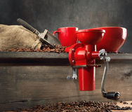 Red coffee mill and coffee beans Royalty Free Stock Photography