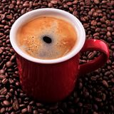 Red coffee mug americano beans background tall square format Royalty Free Stock Photo