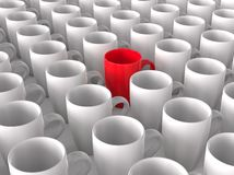Red coffee mug in crowd of white mugs Royalty Free Stock Photos