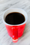 Red coffee mug on marble top. Red mug coffee on marble top Royalty Free Stock Images