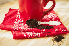 Red Coffee Mug with Napkin and Grounds Royalty Free Stock Photos