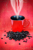 Red coffee mugs and coffee beans Stock Photo