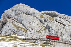 Red cogwheel train at Pilatus, Stock Photo