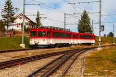 Red cogwheel train on Rigi Mountain, Swiss Alps. Landscape of a red cogwheel train on Rigi Mountain, Swiss Alps. The Rigi Railways are the highest standard gauge stock image