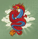 Red Chinese Dragon Tattoo on Green. A red coiled Chinese Dragon Tattoo Stock Images