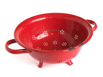 Red colander. An old red pasta colander or strainer isolated on a white background Stock Images