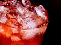 Red cold cocktail  on dark background Royalty Free Stock Photography
