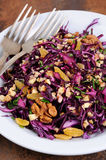 Red coleslaw salad. Salad red coleslaw with raisins and crushed walnut Royalty Free Stock Photos