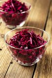 Red coleslaw on wooden background Royalty Free Stock Images