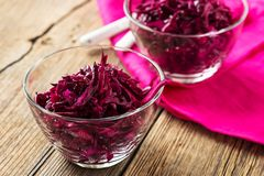 Red coleslaw on wooden background Royalty Free Stock Photography