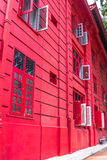 Red Colonial building with red door and red windows Royalty Free Stock Images