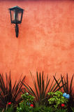 Red Colonial Wall. A red colonial wall with a lantern in the upper left Stock Photos