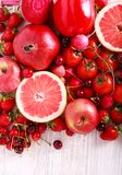 Red color assorted vegetables and fruits. On wooden table Stock Photography